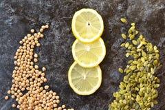 Vegetables. Diet. Nut, lemon and pumpkin seeds Royalty Free Stock Image