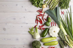 Vegetables of different kinds are lying on a wooden table Stock Image