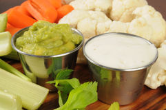 Vegetables and dips Stock Images