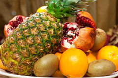 Vegetables. Dish with a variety of fruits, kiwi, oranges, pomegranates, pineapple Stock Images