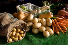 Vegetables on display for sale at market stall. Fresh vegetables on display for sale on a market stall Stock Photo