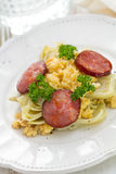 Vegetables with egg and smoked sausage Stock Image