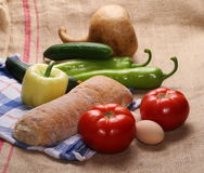 Vegetables, eggs, bread and rag on linen, jute sack background Royalty Free Stock Image