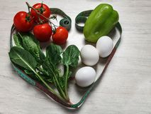 Vegetables and eggs heart-shaped royalty free stock photography