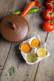 Vegetables, eggs on the old wooden table.Diet concept Stock Images