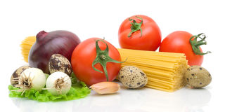 Vegetables, eggs, spaghetti on a white background Royalty Free Stock Photo