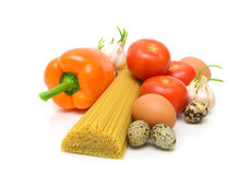 Vegetables, eggs and spaghetti on a white background Royalty Free Stock Photography