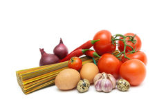 Vegetables, eggs and spaghetti on a white background Royalty Free Stock Photos
