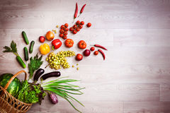 Vegetables explosion from wicker basket. Copy space from right. Horizontal Stock Photos