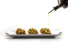Vegetables. With falling oil drops Royalty Free Stock Photos
