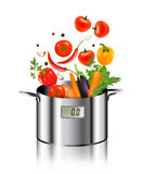 Vegetables falling into a pot. Healthy and diet food concept Stock Photo