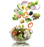 Vegetables Falling Into A  Salad Bowl Royalty Free Stock Images