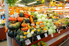 VEgetables on the farm market. Pumpkins and cabbage on the stall with price tag Stock Images