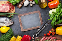 Vegetables, fish and meat cooking Stock Images