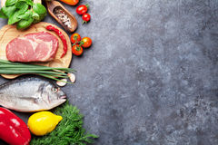 Vegetables, fish, meat and ingredients cooking Stock Photo