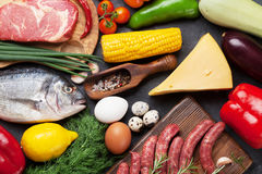 Vegetables, fish, meat and ingredients cooking Royalty Free Stock Photography
