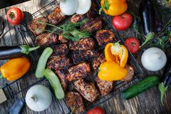 Vegetables, fish, meat and ingredients for cooking. Tomatoes, pepper, corn, beef. Top view on stone table. stock image