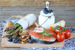 Vegetables,fish,milk products and berries Stock Images