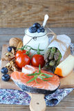Vegetables,fish,milk products on wooden table Royalty Free Stock Images