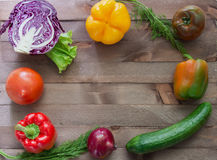 Vegetables flanking the wooden background Royalty Free Stock Image