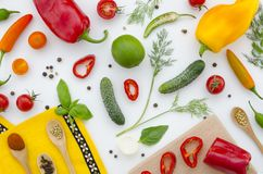 Vegetables flat lay background. Top view of red, yellow and green color vegetables isolated on white background. Stock Photography