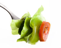 Vegetables on a fork stock photography