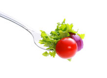 Vegetables on fork. Stock Photos