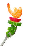 Vegetables on fork Stock Images