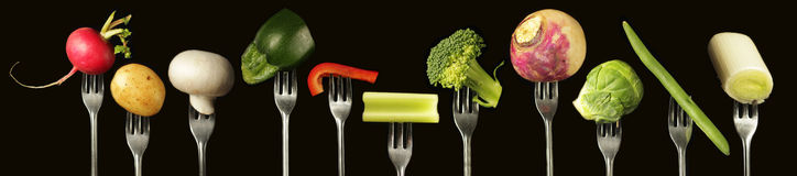 Vegetables on fork Stock Photo