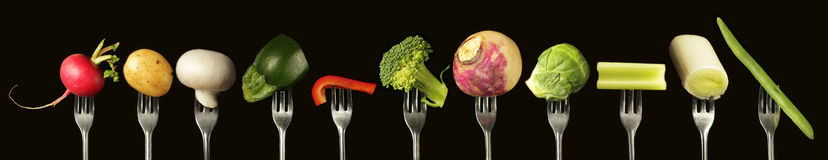 Vegetables on fork Stock Photography
