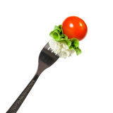 Vegetables on a fork. On a white background royalty free stock photo