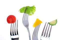 Vegetables on forks. Royalty Free Stock Photos