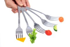 Vegetables on forks. Royalty Free Stock Image