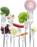 Vegetables on forks Stock Photo