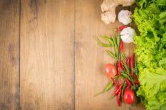 Vegetables Frame Background. Fresh vegetables on the old wooden board Stock Images