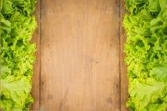 Vegetables Frame Background. Fresh vegetables on the old wooden board Stock Photos