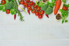 Vegetables. Frame of vegetables. Close-up healthy food composition of organic eating on wooden background. Top view. Selective focus Stock Photos