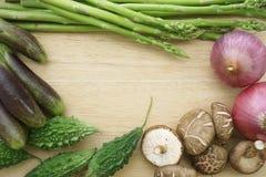 Vegetables frame: Mushroom, onion, asparagus Stock Photos
