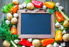 Vegetables frame with slate royalty free stock images