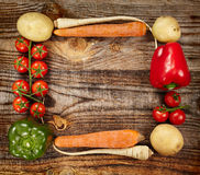 Vegetables frame on wooden board Stock Image