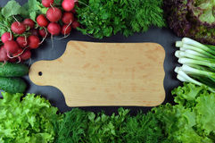 Vegetables and fresh herbs. Concept: proper nutrition. Top view. Stock Image