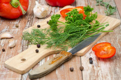 Vegetables and fresh herbs on a on a wooden cutting board Royalty Free Stock Image
