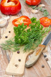 Vegetables and fresh herbs on a on a wooden cutting board select Stock Images