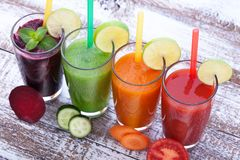 Vegetables, fresh juices mix fruit healthy drinks on wood table. Stock Images