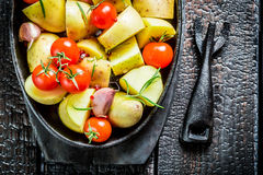 Vegetables with fresh tomato and garlic ready to grill Stock Photo