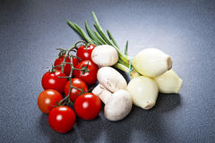 Vegetables fresh tomato with onion, garlic and spices Stock Photo