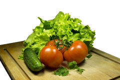 Vegetables. Fresh vegetables on a wooden table with isolated background Stock Photos