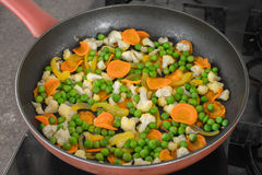 Vegetables fried in a pan. Different vegetables fried in a pan Royalty Free Stock Photography