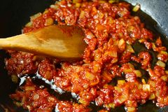 Vegetables fried in sauce, ingredients, cooking at home and in the restaurant, Mexican cuisine royalty free stock photography
