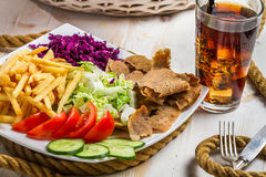 Vegetables, fries and meat kebab Stock Images